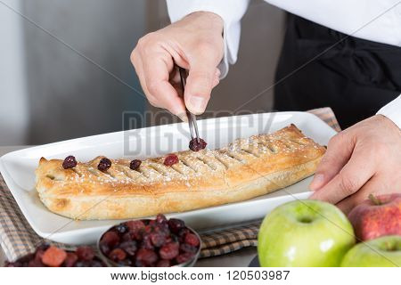 Chef Finishing His Cake