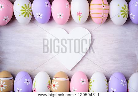 Easter Eggs And Wooden Heart  On A Grey Wooden Background