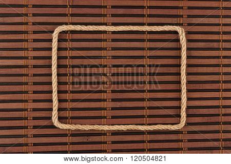 Frame Of Rope, Lies On A Background Of A  Bamboo Mat