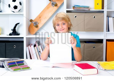 Boy On Desk With Good Report Card