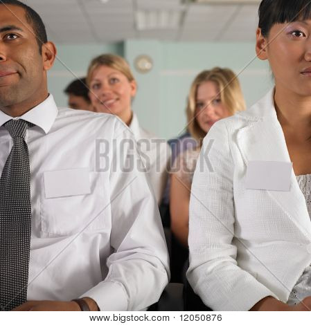 Businessman and woman in conference
