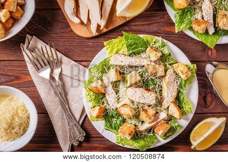 Homemade Chicken Caesar Salad With Cheese And Croutons.