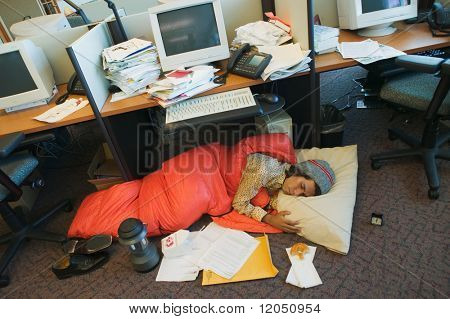 Businessman camping in office