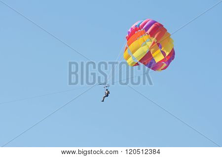 Man Floating In The Sky On A Parachute