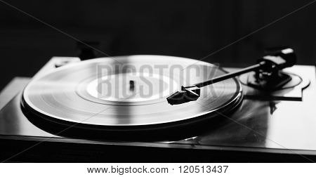 Vintage record player with vinyl disc, close-up