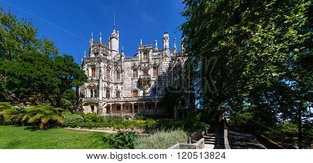 Sintra, Portugal - July 14, 2015: Regaleira Palace facade and Gardens. A neo-manueline palace decorated with alchemy and freemasons symbols.