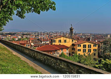 View over Bergamo Bassa from the path along the walls around Bergamo Alta, Lombardy, Italy