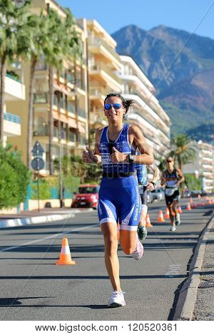 Woman Runner In Blue Suit