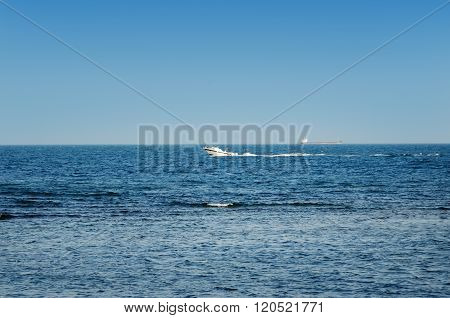 Motor Boat In Sea On A Background Of Blue Sky