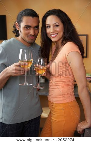 Portrait of couple drinking white wine
