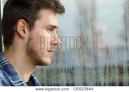 Man Longing And Looking Through Window