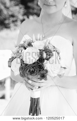 Happy bride with beautiful wedding bouquet black and white,