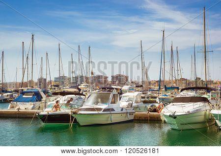 Puerto Deportivo Marina Salinas. Cute Girl In Bikini Wash Yacht In Marina Of Torrevieja, Valencia, S