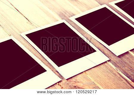 Instant Empty Polaroid Photos Frames On Wooden Background.
