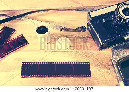 Retro Vintage Camera On Wooden Background.