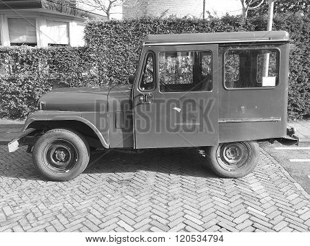 Hilversum, The Netherlands - March 5, 2016: U.S. Mail Postal Dispatcher Jeep parked by the side of the road in the city of Hilversum. Nobody inside inside the vehicle.