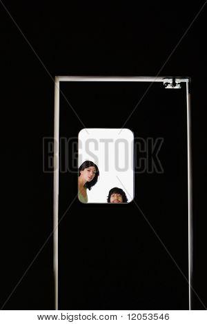 People standing behind door window