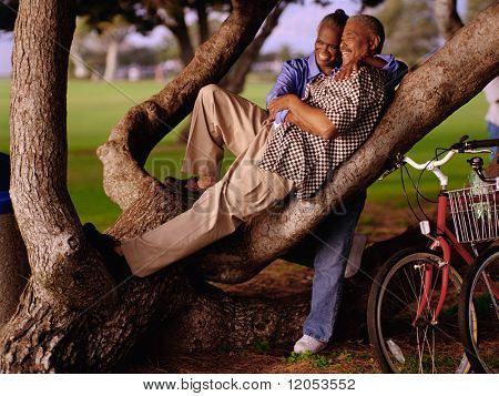Couple relaxing in tree
