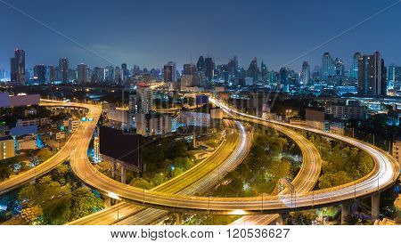 Aerial view highway road curved with city downtown background