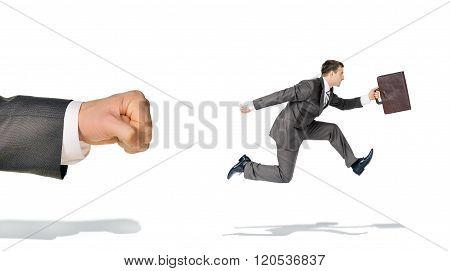 Businessman runaway from big fist