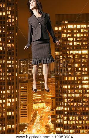 Businesswoman floating above the city