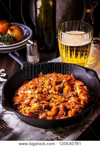 Stewed Cabbage  In A Vintage Frying Pan And A Mug With Beer.
