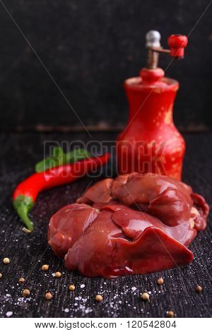Chicken Raw Liver On A Black Background With Spices