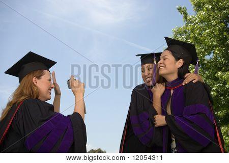 Female graduates taking pictures