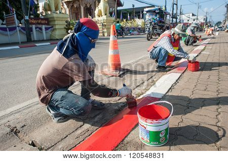 Road Workers Paint Borders
