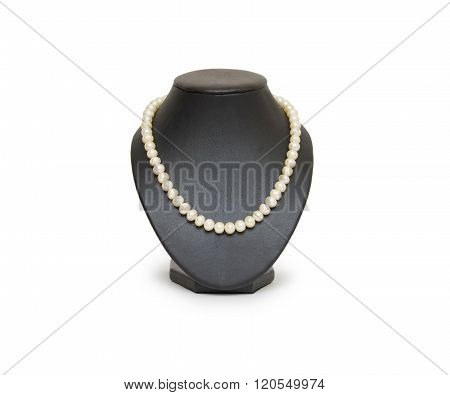 Pearl necklace on black mannequin isolated on white