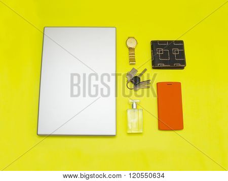 Different Objects On Yellow Background.