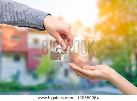 Man Is Handing A House Key To A Woman. Real Estate Concepts.