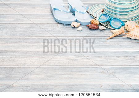 Beach Accessories On Wooden Board.