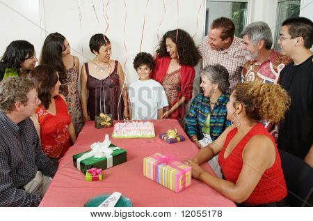 Family at young boy's birthday party