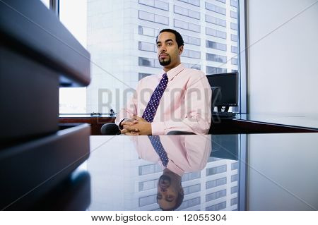 Businessman sitting behind desk