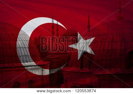 Turkish flag with view of Blue mosque in Istanbul seen in background