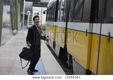 Businessman shouting at a passing train