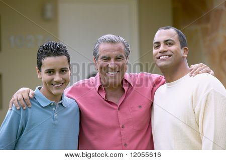 Three generations of men standing together