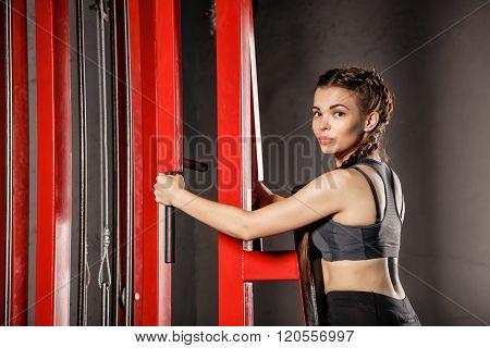 Girl Doing Exercises At Sports Simulator.