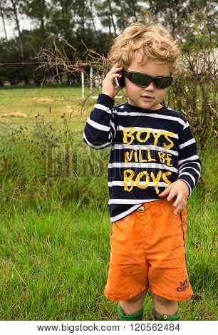 Cool Toddler On Farm Talking On Pretend Mobile Phone