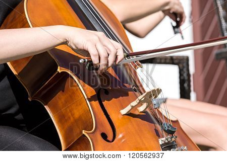 Woman's Hand Playing Cello In The Orchestra