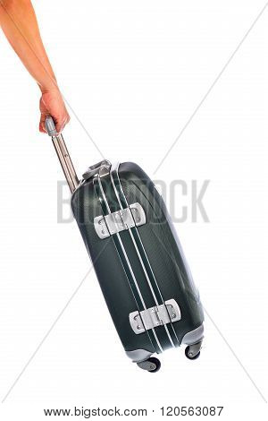 Human Hand Carry Polycarbonate Suitcase On White Background