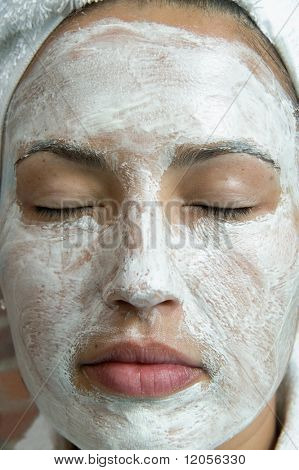 Close up of woman with beauty mask on face