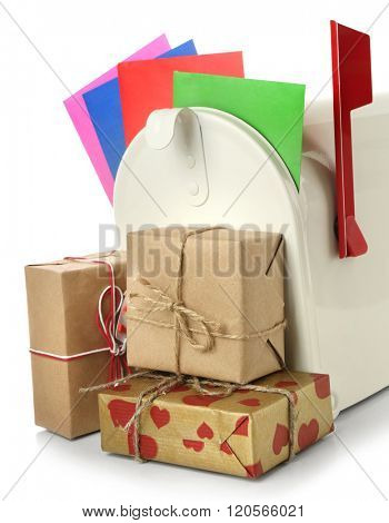 Mailbox with gift boxes and correspondence isolated on white