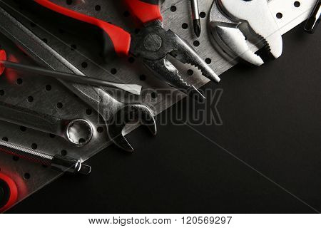 Different kinds of tools on dark background
