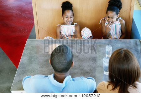 Family in booth at restaurant