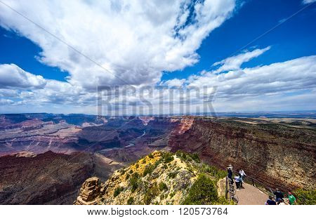 Grand Canyon, USA - May 24, 2011: Tourists in the foreground looking at the Grand Canyon South Rim.