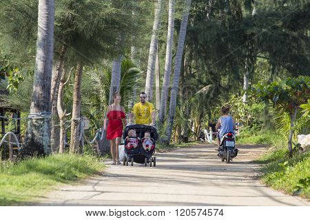 KOH PHANGAN THAILAND - DECEMBER 30 2015 : Unidentified tourists with children come to rest on the Thai island. Thailand is an attractive place to relax tourists come from all over the world
