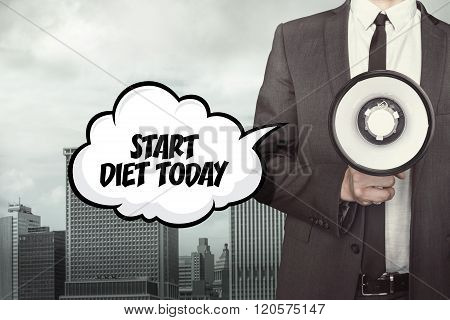 Start diet today text on speech bubble with businessman and megaphone