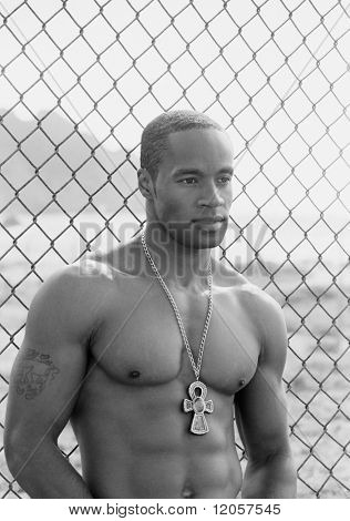 Young shirtless man wearing a pendant
